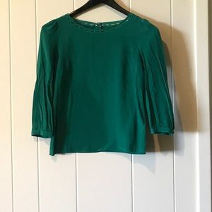 Gorgeous green silk top. Feminine details